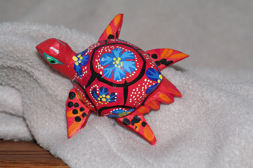 brightly colored turtle carving